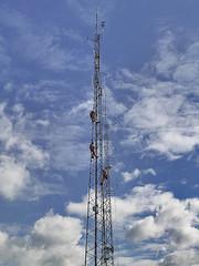 Telecoms Mast With 3 Men Working Aloft In A Bright Spring Sky (frogdog*) Tags: clouds derbyshire mast alport telecommunication mobilephonemast ambervalley alportheights telephonemast blueskyclouds shottle telecommunicationmast telecomsmast gettyimageswants menworkingaloft
