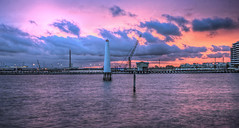 Waterfront sunset colors (J-C-M) Tags: pink sunset orange lighthouse water colors clouds port photoshop pier nikon waterfront crane d70s melbourne princes hdr topaz 3xp photomatix