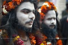 Naga Sadhus, Juna Akhara, Kumbh Mela (© Poras Chaudhary) Tags: flowers portrait orange india ash uttaranchal baba sadhu naga juna mela haridwar akhara kumbh uttarakhand