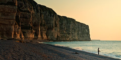 On The Waterfront (Allard One) Tags: sunset seascape france strand landscape zonsondergang nikon rocks waterfront pebbles visser explore normandie frankrijk portfolio cobbles fp frontpage normandy 2009 etretat rotsen seinemaritime natuurschoon hautenormandie krijtrotsen shinglebeach explorefrontpage d80 nikkor1755mmf28 badplaats nikond80 lonelyfisherman aandewaterkant kiezelstrand allardone allard1 cliffsandnaturalarches wheretheatlanticoceanmeetsthebritishchannel massivebutvulnerable 21panoramacrop allardschagercom
