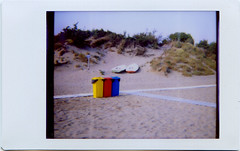 o caroline (toscana11) (juri_kid_a) Tags: blue red italy color yellow boats lomo lomography sand italia colore fuji blu may barche pisa diana giallo tuscany instant toscana rosso maggio analogica sabbia instax tirrenia 2011