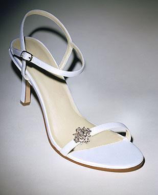 Shoe design married with a beautiful brooch.
