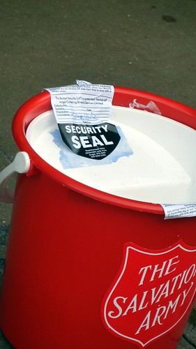 Salvation Army Charity Bucket security seal, Oxford Street, London, UK.JPG