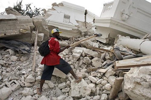 Man Recovers Shoe from Collapsed Justice Palace in Port-au-Prince. Photo: United Nations Photo, flickr.