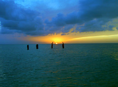 Holbox (pichucastro) Tags: ocean blue light sunset sea sky sun luz sol azul mxico clouds cormorants mar yucatan cielo nubes siluetas oceano holbox mejico