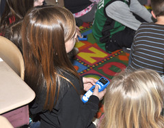 "A second-grader at Valley View Elementary School in Portland, CT uses a clicker to answer questions posed at the end of a language arts video lesson about ""cause and effect."""