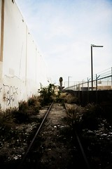 lack of a destination overruns the path (grigoriprime) Tags: city urban abstract abandoned grass canon industrial decay tracks faded 5d deco harsh urbex gregified stupidautomatictagthatidontwant