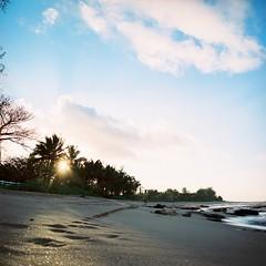AR09798_AR09798-R1-E011 (Alicia J. Rose) Tags: ocean sky clouds hawaii dance tsunami clay northshore kauai waimeacanyon 2010 volcanicrock mountainrange communing beachphotography hawaiinislands kauainorthshore aliciajrose rambuton sparklingbeach halfwaycommietsunamimommy gettyvacation2010