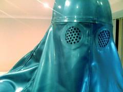 Looking at the TV (latexladyll) Tags: fetish veil rubber latex blueburqa