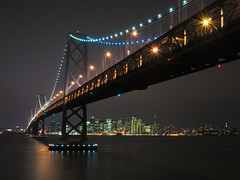 Bay Bridge in the Rain - San Francisco, California (kendra just is) Tags: ocean sanfrancisco california city longexposure blue sea sky orange color reflection water night landscape gold lights bay colorful cityscape pacific tripod scenic wideangle shore lee baybridge vista gitzo yerbabuenaisland nikon1870mm markins markinsm10ballhead nikond300 kendrakarr