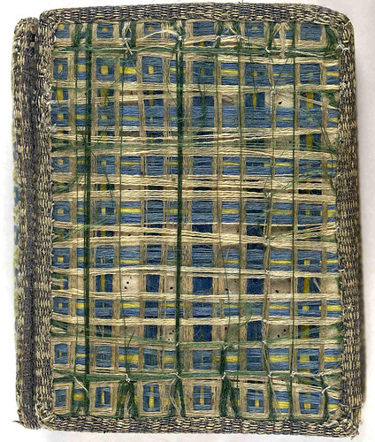 17th century satin embroidered book cover with threads of coloured silk 'woven' across upper and lower covers.