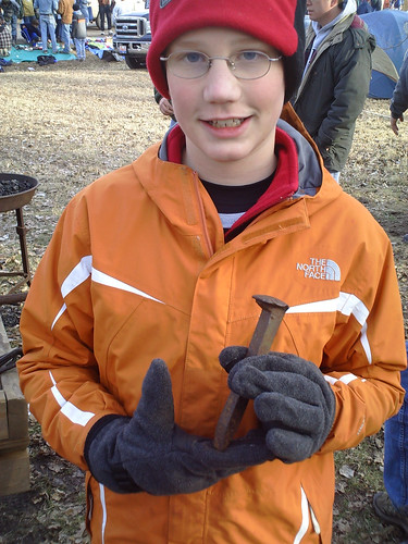 A railroad spike traded for turkey feathers