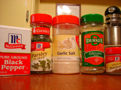 jars of spices: black pepper, parsley, garlic salt, oregano, marjoram