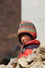 Nice and warm (stevefhobbs) Tags: nepal boy mountain mountains face hat happy warm glow child coat north nepalese region khumbu everest unhappy himalayas himalayan khumjung nepali
