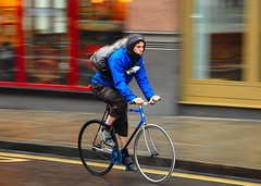 Blue jacket and bike (jeremyhughes) Tags: road street city uk blue urban motion london bike bicycle speed cycling movement nikon cyclist zoom cycle singlespeed fixie nikkor courier panning rider vr cityoflondon squaremile d40 fixedwheel 18200mmf3556gvr nikond40