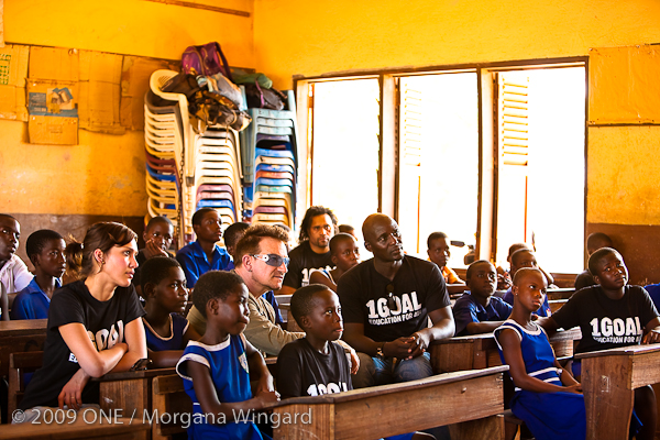 Jessica Alba, Bono, Christian Karembeu, and Tony Baffoe at school in Ghana
