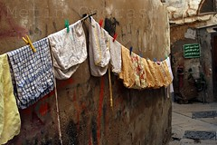 The Wall of Fortune (metini) Tags: yellow wall rags clips arabic clothes laundry acre akko laundryclips