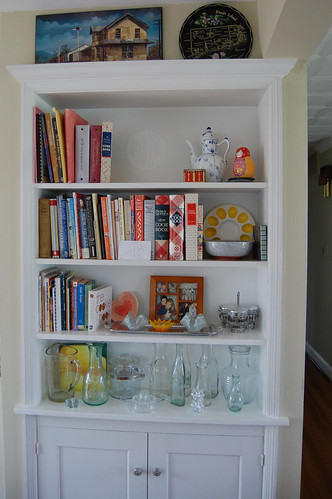 built-in bookshelf in the dining room