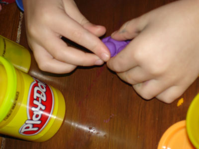 series of pictures of my kids playing with playdough