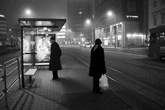 Foggy communication (between a man & a woman) (Gilderic Photography) Tags: street city light shadow urban bw woman white mist cinema man black bus lamp silhouette fog backlight night canon eos mono blackwhite europe raw noir mood darkness femme perspective foggy rail center nb ombre story stop lumiere slovensko slovakia avenue cinematic rue abribus nuit tramway blanc bratislava brouillard contrejour brume homme lightroom 500d slovaquie gilderic