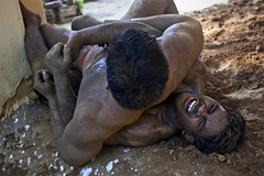 Throw ( Jakub Jurkowski) Tags: people india man building men muscles sport naked pain fight team sand mud body muscle wrestling traditional august dirt varanasi tradition 2008 throw malla ganga ganges kushti kusti jurkowski