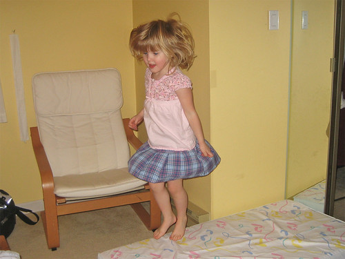 Hannah jumping on the crib mattress