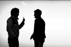 Flipping the Bird (joyjwaller) Tags: people blackandwhite men beauty japan tokyo intense shadows middlefinger argument angst shinjukustation confrontation flippingthebird hanggestures theycallthisaheateddiscussionwhereimfrom brilliantwhitenothingness