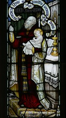 Detail stained glass song Simeon holding Jesus in his arms