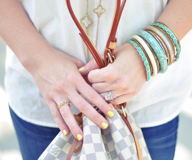 yellow nails + vintage bangles + bracelets + alhambra necklace + louis vuitton azur noe bucket bag + rings