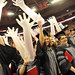 College of Veterinary Medicine graduates get a glove wave happening before the beginning of commencement.