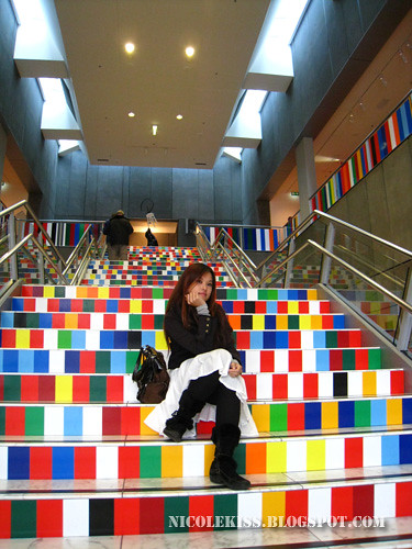nicole posing on colorful steps