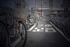 Bikes at Nagano Station, Japan (JohannSchmidt) Tags: tower castle japan jo matsumoto nagano naganoprefecture  matsumotojo matsumotocastle hirajiro