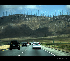 Power Battle: Petroleum vs the Wind (PetterPhoto) Tags: california road ca usa cars car truck drive march highway war energy driving power motorway state wind hill battle gas clean route pollution mojave oil change trucks lordoftherings interstate vs towards climate crisis petroleum ca58 tahachapi petterphoto nofk