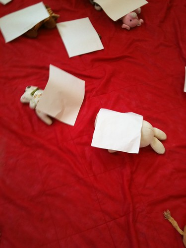 Teddy bears under paper