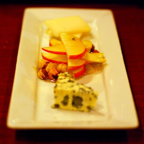 cheese plate with apples, hazelnuts and thyme honey