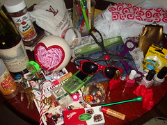 Reds and Greens (Huge Cool) Tags: pink red green sunglasses heart cellphone scissors tape nectar pens nailpolish bourbon jellybeans burtsbees anise pencilsharpener chapstick paperchase mintchocolate targetbag candycanepen fakeflowerpen