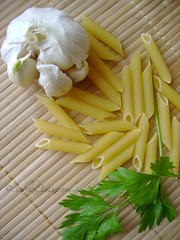 Pasta, garlic, parsley, main ingredients for Penne all'Arrabbiata