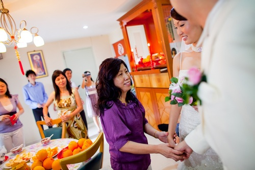 Mother of bride entrusting daughter to the groom