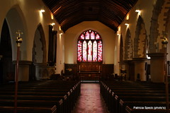 (Patricia Speck) Tags: light shadow church architecture candles arches aisle tricia pillars alter patricia pews stainedglasswindow speck