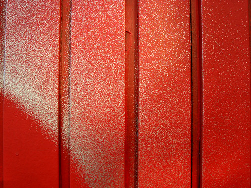 Silver Spraypaint and Shadows on Red
