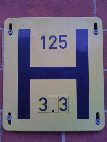 "Yellow ""H"" hydrant sign"