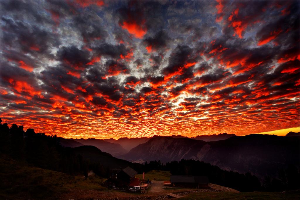 Sunset overlooking a cabin on a mountain ridge.  Credit to Eddi (traumlichtfabrik).