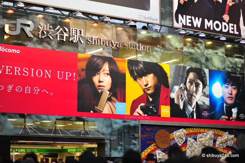 NTT DoCoMo working its ads on Shibuya Station building. Who is your favorite from this set of 4?