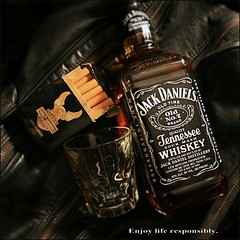 Black leather accessories.. (europeanasian) Tags: black whiskey harley liquor alcohol booze cigarettes smokes jackdaniels shotglass cigs blackleather tennesseewhiskey harleydavidsoncigs