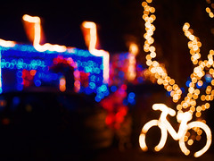 Tucked up warm at Christmas (Pollylop) Tags: christmas blue red white bicycle yellow lights christmaslights merrychristmas eathorpe