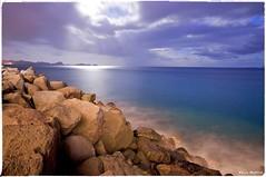 Rocks and Mountains (Paul Raptis) Tags: ocean santa blue sea mountains portugal night island photography nikon rocks sigma cruz hour 1020mm madeira funchal d90 borderfx