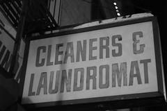 Cleaners & Laundromat (robertklurfield) Tags: street nyc bw newyork color night dark blackwhite lowlight manhattan streetshots nightshots lowermanhattan streetscenes afterdark nightshooting canon5014 streetshooting leicam8