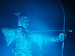 Robin always used to moonlight for Cupid at this time of Year (DaveKav) Tags: nottingham uk greatbritain blue england robin statue unitedkingdom britain olympus illuminated gb robinhood nottinghamshire e510 lightnight lightnight2010