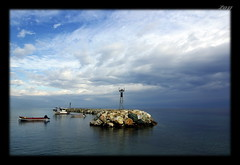 Breakwater..... (Zopidis Lefteris) Tags: new blue sea sky clouds landscape hellas greece macedonia cassandra kassandra allrightsreserved 2010 breakwater chalkidiki halkidiki lefteris  xalkidiki      zop  fokaia zopidis            photographerzopidislefteris newfokaia   neafokaia  photographerzopidislefterisc c  allphotosarecopyrightedbyzopidislefteris  copyright