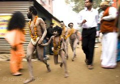 A young Naga Baba walks with a Naga Baba at the Kumbh Mela 2010, Haridwar, India (sanjayausta) Tags: pictures people india men saint festival naked nude religious photography bath asia nudes child indian faith religion young festivals traditions smoking full holy pot exotic photographs gathering take warrior ritual procession bathing nudity marijuana population devotees hindu hinduism dip festivities maha crowds baba sanjay babas largest sadhu 2010 naga rituals mela nagas haridwar the photoessay throngs austa sadhus kumbh photodocumentary ascetics